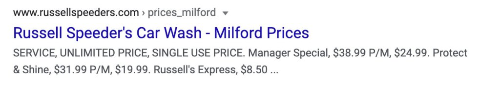 Screenshot of Google search result with Russel Speeder's Car Wash - Milford Prices in blue as the heading. Subtext lists prices and ends in ellipse indicating description is too long for the container.